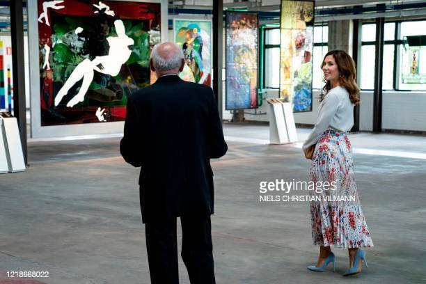 Crown Princess Mary of Denmark view artworks on June 8 while attending the opening of the designer museum Holmegaard Vaerk in Naestved some 75km...
