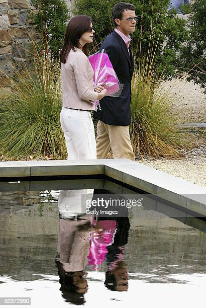 Crown Princess Mary of Denmark walks past the Pool of Reflection memorial lwith her husband Crown Prince Frederik during a visit to the ruins of the...
