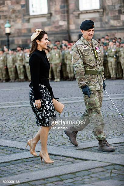 Crown Princess Mary of Denmark walks with Chief of Defence General Peter Bartram during her participation in the Flag Day parade for international...