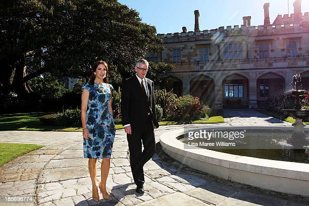 Crown Princess Mary of Denmark walks with Christopher Sullivan in the gardens of Government House on October 24 2013 in Sydney Australia Prince...
