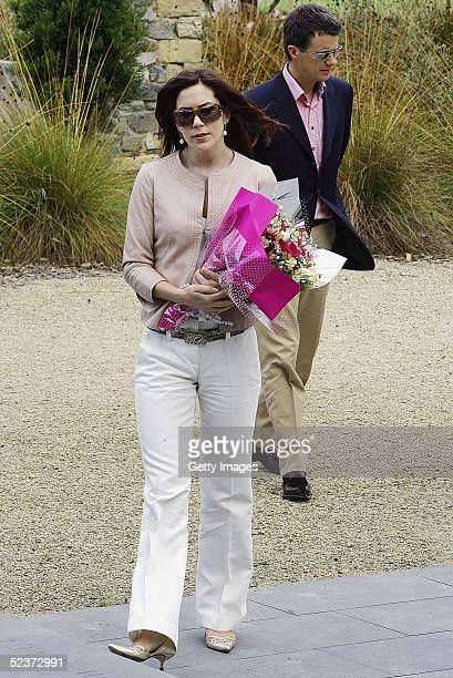 Crown Princess Mary of Denmark walks with her husband Crown Prince Frederik during a visit to the ruins of the Broad Arrow Cafe on March 11, 2005 in...