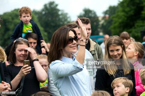 Crown Princess Mary of Denmark waves during the 'Children's Relay Run' in Faelledparken on June 10 2017 in Copenhagen Denmark The kids relay run is...
