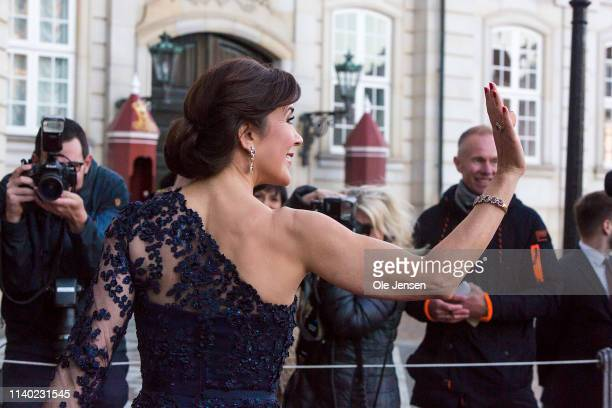 Crown Princess Mary of Denmark waves to sperctators during arrival at Princess Benedikte of Denmarks 75th birthday party hosted by Queen Margrethe of...