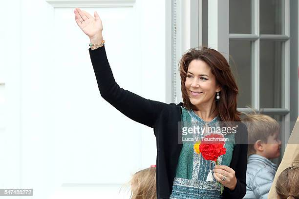 Crown Princess Mary of Denmark waves to the photographers at the annual summer photo call for The Danish Royal Family at Grasten Castle on July 15,...