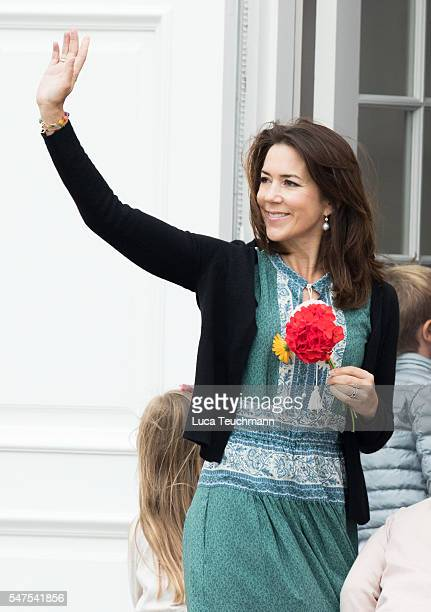 Crown Princess Mary of Denmark waves to the photographers at the annual summer photo call for The Danish Royal Family at Grasten Castle on July 25...