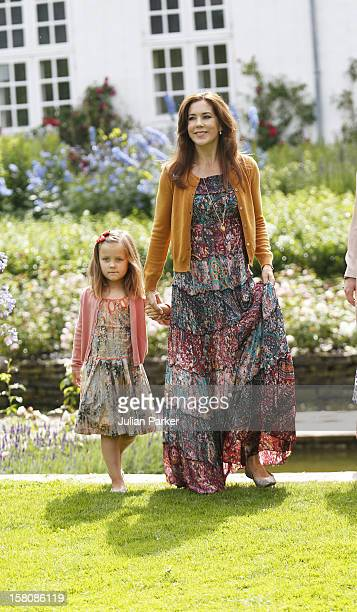 Crown Princess Mary Of Denmark With Princess Isabella Of The Danish Royal Family Hold A Family Photocall At Grasten Palace In Southern Denmark