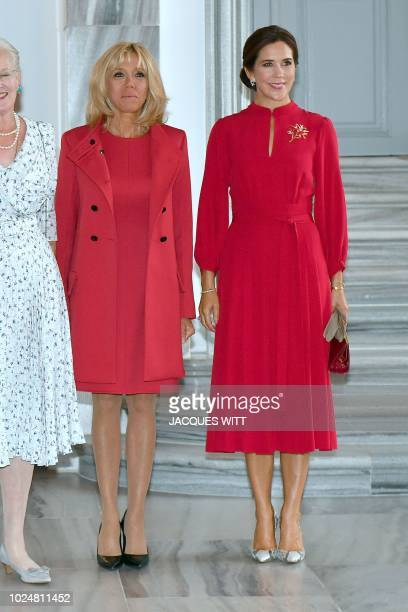 Crown Princess Mary poses with French President Emmanuel Macron's wife Brigitte Macron upon arrival at the Amalienborg Castle in central Copenhagen...