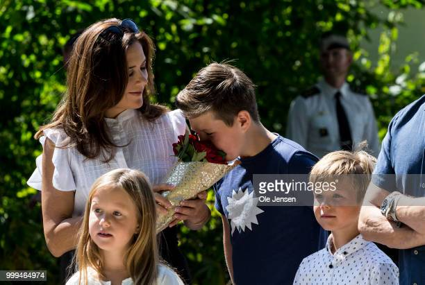 Crown Princess Mary Princess tease Prince Christian with a flower bouquet during he Tilting-At-The-Ring Riders Event at Graasten Castle at Graasten...
