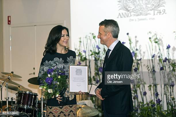 Crown Princess Mary receives 'The Berlingske Foundation's' Honorary Award presented by Mads Bryde chair of 'The Berlingske Foundation' at The...