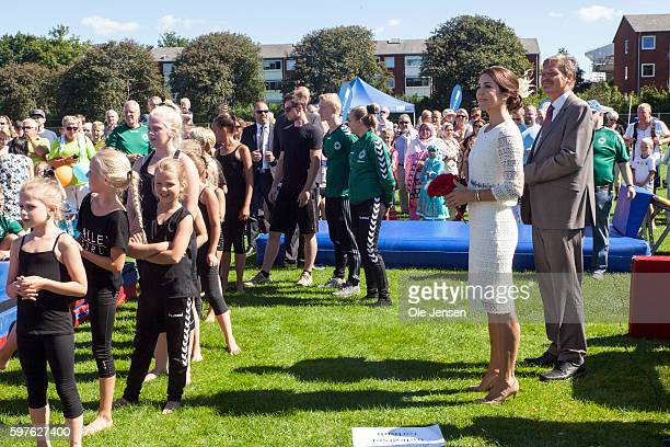 Crown Princess Mary watches young gymnast performing during her visit to the city of Glostrup's 850 year anniversary in Denmark on August 27 2016