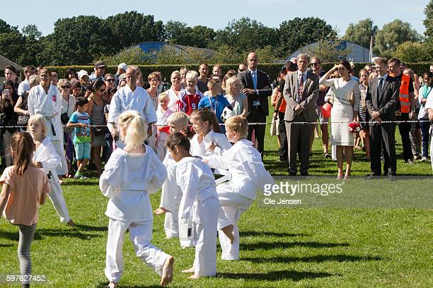 Crown Princess Mary watches young local martial art practitioners during her visit to the city of Glostrup's 850 year anniversary in Denmark on...