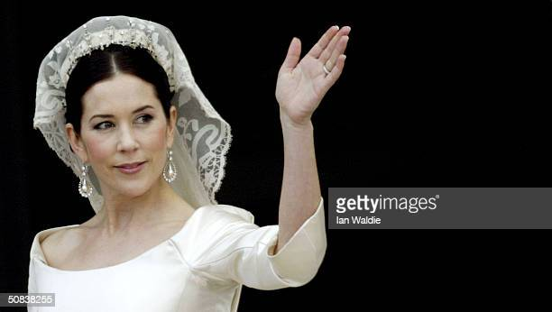 Crown Princess Mary waves from the balcony of Christian VII's Palace after her wedding to Crown Prince Frederik of Denmark on May 14 2004 in...