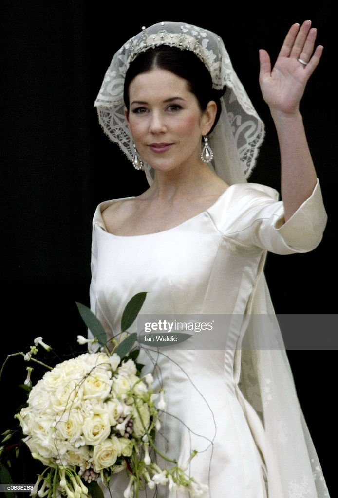 Crown Princess Mary waves to the crowd as the she and Crown Prince Frederik of Denmark arrive at Christian VII's Palace after their wedding on May 14, 2004 in Copenhagen, Denmark. The romance began in 2000 when Miss Mary Elizabeth Donaldson met the heir to one of Europe's oldest monarchies over drinks at the Sydney Olympics, where he was with the Danish sailing team.