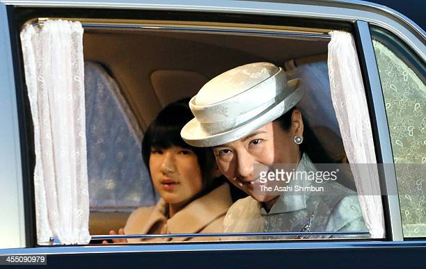 Crown Princess Masako and Princess Aiko are seen upon arrival at the Imperial Palace on December 9 2013 in Tokyo Japan Crown Princess Masao turns 50