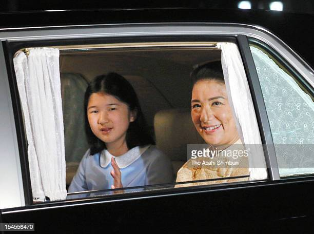 Crown Princess Masako and Princess Aiko smile as they visit Emperor Akihito and Empress Michiko to celebrate Empress' 78th birthday at the Imperial...