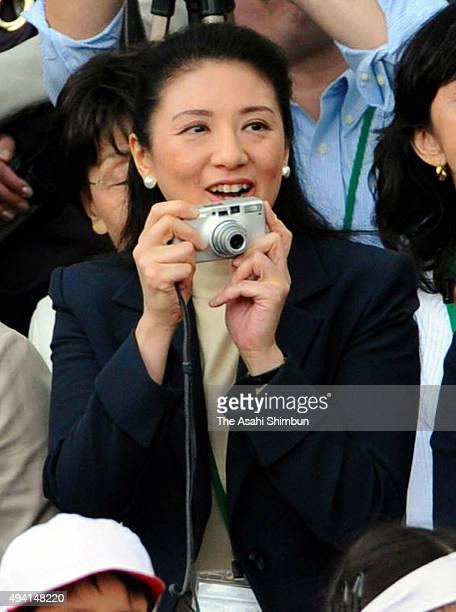 Crown Princess Masako holds a camera to take photographs of her daughter Princess Aikoduring the Gakushuin Elementary School Sport Festival on...