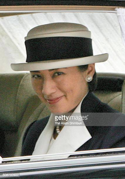 Crown Princess Masako is seen on arrival at the Imperial Palace to see off Emperor Akihito and Empress Michiko prior to their visit to Saipan on June...