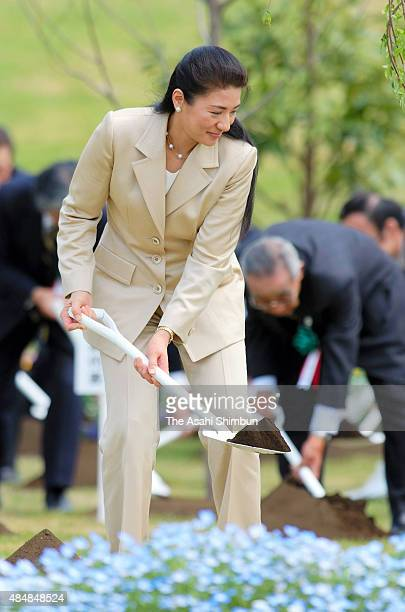 Crown Princess Masako plant a young tree during the national greening promotion event during their visit to Kanagawa on April 19 2009 in Yokohama...