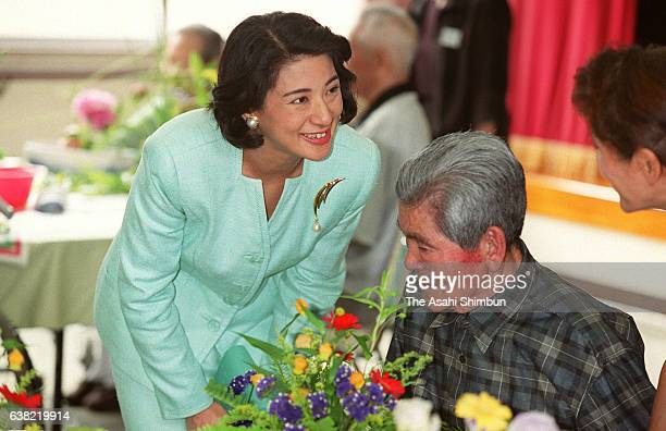 Crown Princess Masako talks to a resident as she visits nursing home for elderly people on May 18 2000 in Yaku Kagoshima Japan