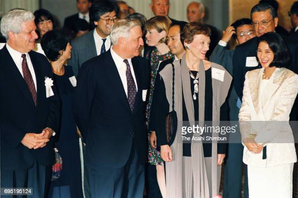 Crown Princess Masako talks with the US Ambassador to Japan Walter Mondale and his wife during a reception hosted by Harvard University on June 11...