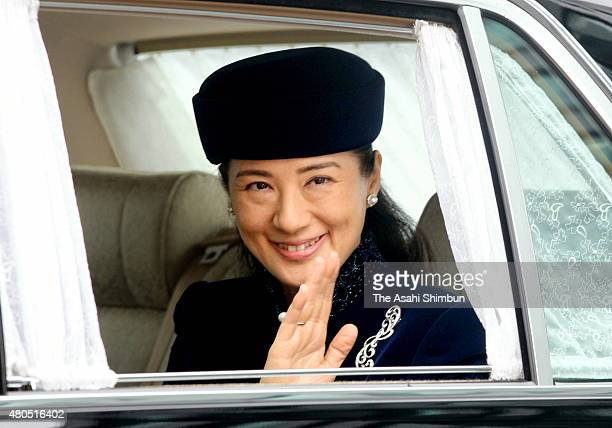 Crown Princess Masako waves to media reporters on arrival at the Imperial Palace as she turns 48 on December 9 2011 in Tokyo Japan