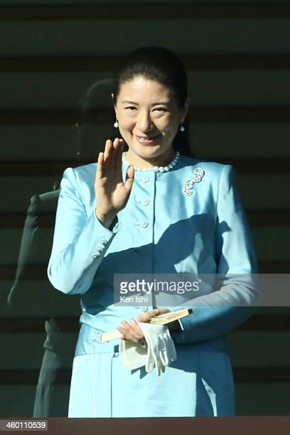 Crown Princess Masako waves to wellwishers during celebrations for the New Year on the veranda of the Imperial Palace on January 2 2014 in Tokyo...