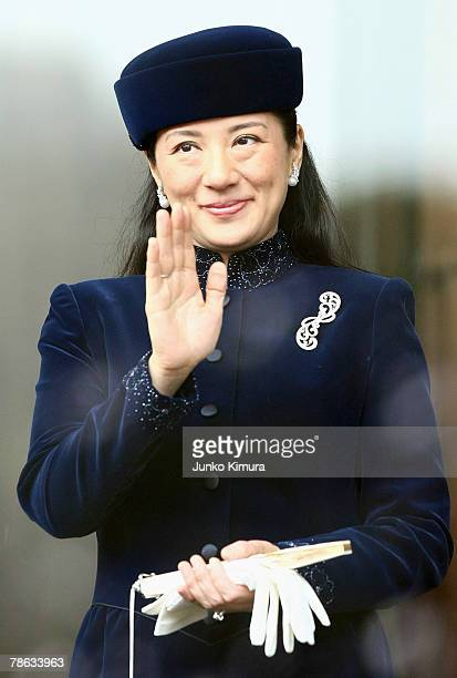 Crown Princess Masako waves to wellwishers gathered to celebrate Emperor Akihito's birthday at the Imperial Palace on December 23 2007 in Tokyo Japan...