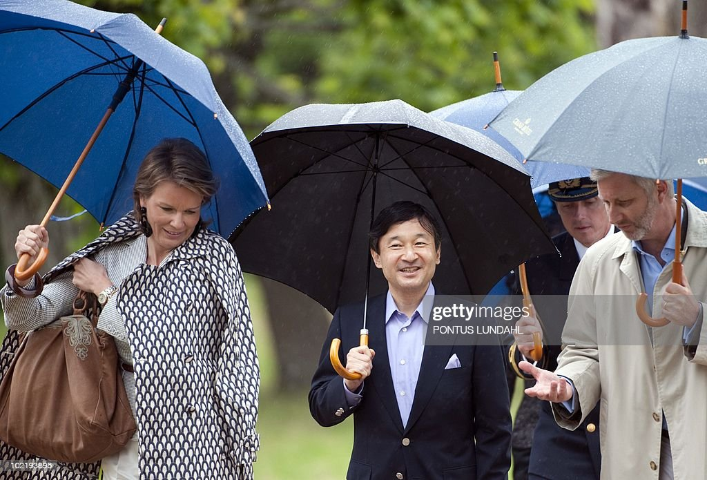 Crown Princess Mathilde of Belgium (left-right), Japan's Crown Prince Naruhito and Crown Prince Philippe of Belgium carry umbrellas upon their arrival to Sturehof castle, south of Stockholm, on June 18, 2010, to attend a lunch hosted by the Swedish King Carl Gustaf and Queen Silvia as part of this weekend's wedding celebrations. Sweden's Crown Princess Victoria will marry her finacee Daniel Westling on Saturday, June 19.