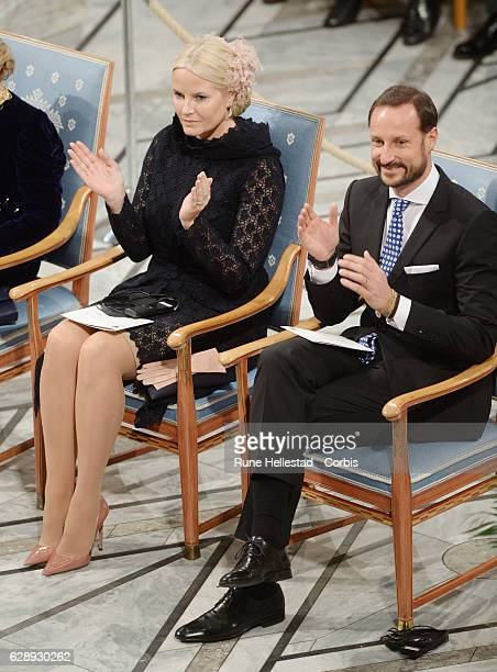 Crown Princess Mette Marit and Crown Prince Haakon of Norway attend the Nobel Peace Prize ceremony at Oslo City Town Hall on December 10, 2016 in...