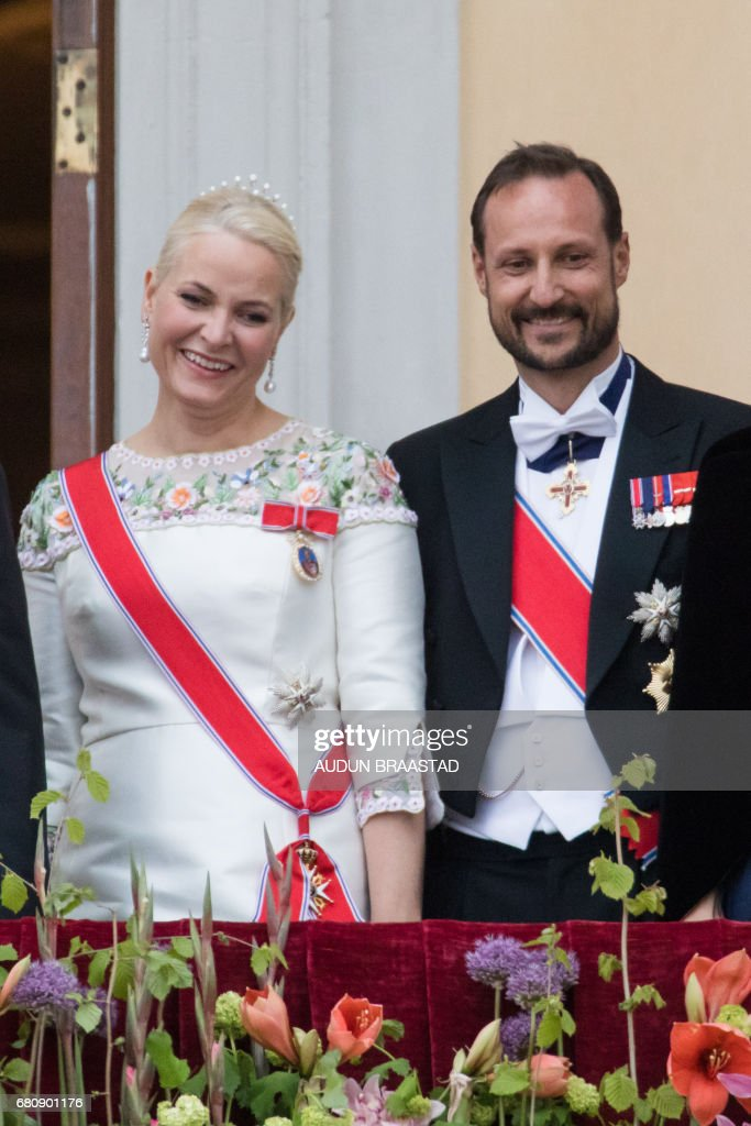 Crown Princess Mette Marit and Crown Prince Haakon of Norway greet wellwishers from the balcony of the Royal Palace in Oslo, Norway on May 9, 2017 to mark the 80th Birthday of the King and Queen. PHOTO / NTB scanpix AND NTB Scanpix / Audun BRAASTAD / Norway OUT