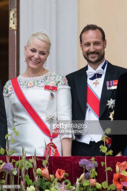 Crown Princess Mette Marit and Crown Prince Haakon of Norway greet wellwishers from the balcony of the Royal Palace in Oslo Norway on May 9 2017 to...
