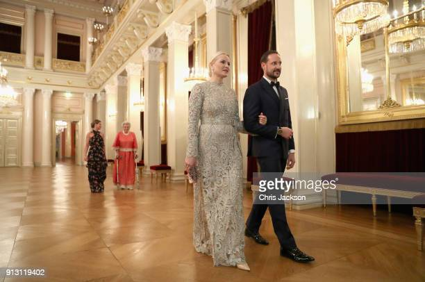 Crown Princess Mette Marit of Norway and Crown Prince Haakon of Norway walk into dinner at the Royal Palace on day 3 of the royal visit to Sweden and...