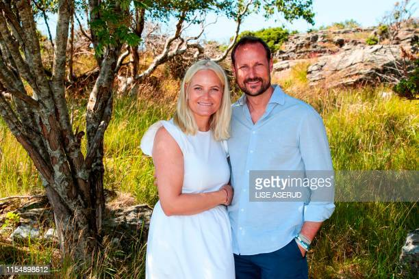 Crown Princess Mette-Marit and Crown Prince Haakon pose at the country house on Dvergsoya outside Kristiansand, on July 10, 2019. / Norway OUT