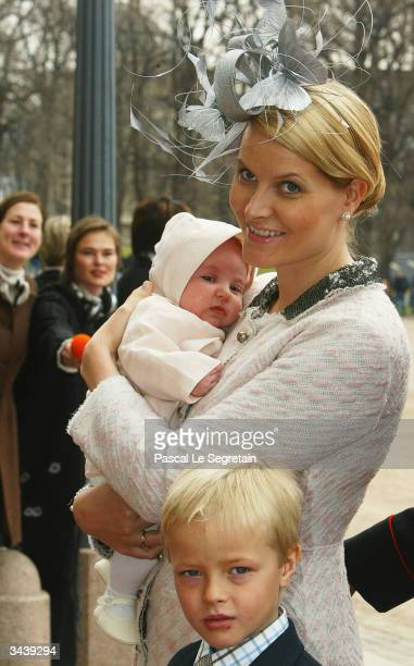 Crown Princess MetteMarit holding Princess Ingrid Alexandra and her halfbrother Marius Hoiby as they arrive at the christening of Princess Ingrid...