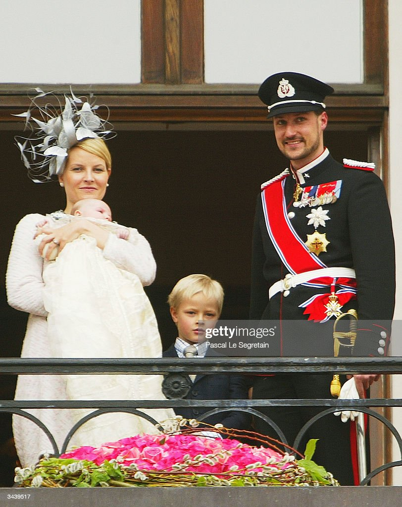 Crown Princess Mette-Marit holding Princess Ingrid Alexandra, her son Marius Hoiby, and Crown Prince Haakon greet the public from the balcony of the royal palace after the christening of Princess Ingrid Alexandra - daughter of Crown Prince Haakon and Crown Princess Mette-Marit on April 17, 2004 in Oslo, Norway. The Princess was born on January 21, 2004 and is second in line to the throne.