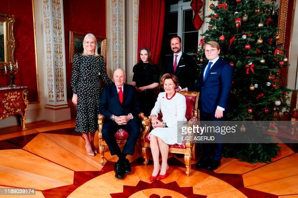 Crown Princess MetteMarit King Harald Princess Ingrid Alexandra Crown Prince Haakon Queen Sonja and Prince Sverre Magnus pose for a picture next to...