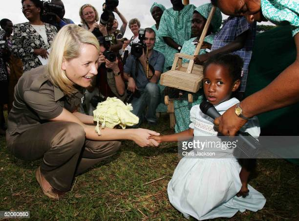 Crown Princess MetteMarit of Norway accepts a Malawian toy house as a gift for her son from an AIDS orphan at NASFARM a farming patnership in Zomba...