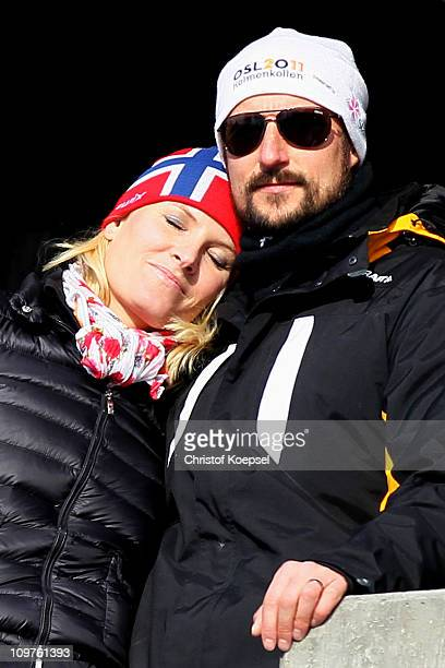 Crown Princess Mette-Marit of Norway and Crown Prince Haakon of Norway attend the Men's Cross Country 4x10km Relay race during the FIS Nordic World...