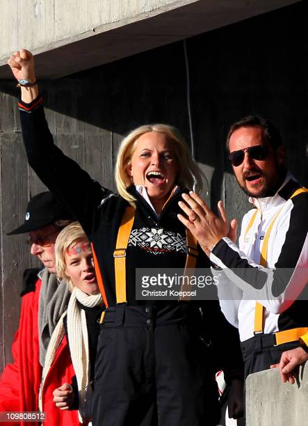 Crown Princess MetteMarit of Norway and Crown Prince Haakon of Norway cheer on Petter Northug of Norway as he wins the gold medal in the Men's Cross...