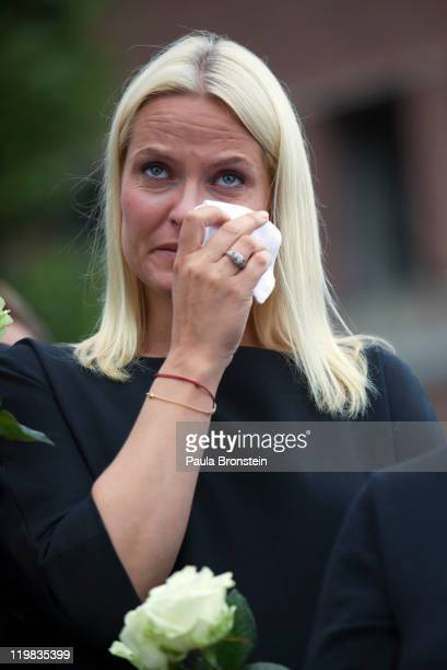 Crown Princess MetteMarit of Norway cries as thousands of people gather at a memorial vigil following Friday's twin extremist attacks on July 25 2011...