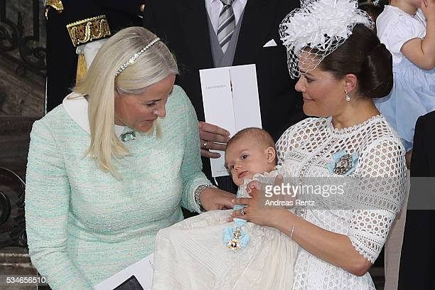 Crown Princess MetteMarit of Norway Crown Princess Victoria of Sweden and Prince Oscar of Sweden are seen after the christening of Prince Oscar of...