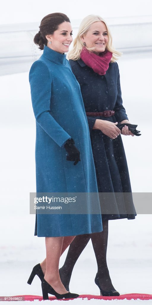 Crown Princess Mette-Marit of Norway greets Catherine, Duchess of Cambridge as she arrives at Oslo Gardermoen Airport on day 3 of their visit to Sweden and Norway on February 1, 2018 in Oslo, Norway.