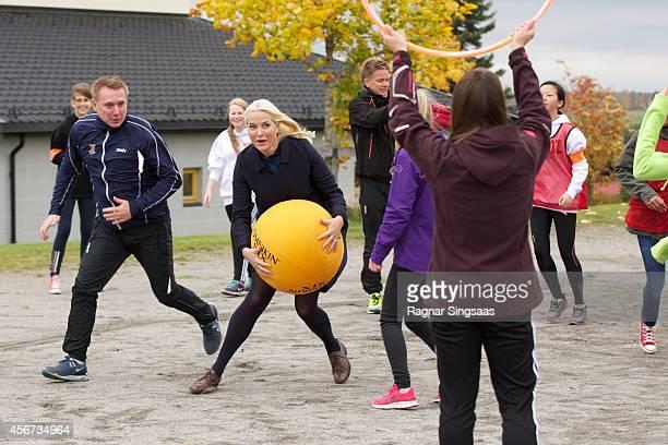Crown Princess MetteMarit of Norway visits Trivselslederne at Runni Comprehensive School on October 6 2014 in Arnes Norway