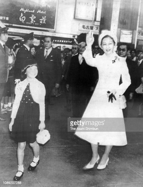 Crown Princess Michiko and Princess Sayako wave to well-wishers on arrival at Uji Yamada Station on November 7, 1978 in Ise, Mie, Japan.