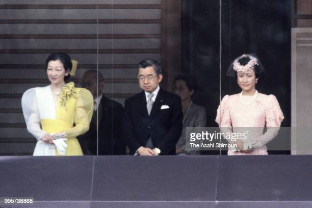 Crown Princess Michiko, Prince Hitachi and Princess Hanako of Hitachi attend the celebration session as Emperor Hirohito turns 85 at the Imperial...