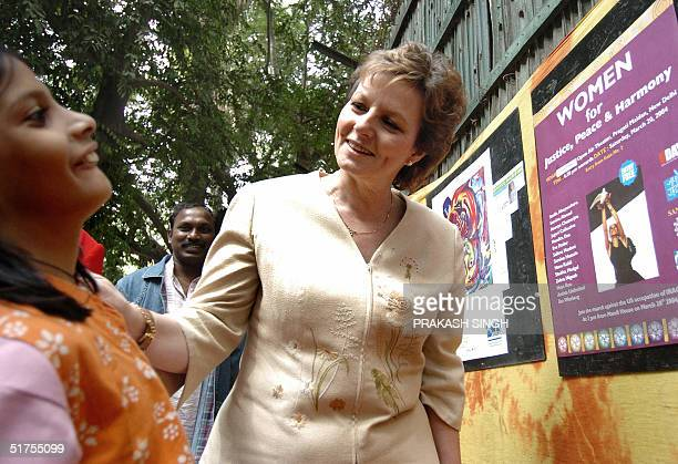 Crown Princess of Romania Margarita speaks with an Indian girl during an exhibition organised by the charitable public trust 'Act Now for Harmony and...