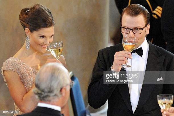 Crown Princess Victoria and fiance Daniel Westling give a toast as they attend the Government PreWedding Dinner for Crown Princess Victoria of Sweden...