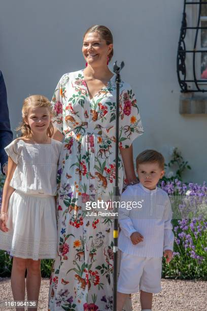 Crown Princess Victoria and her children Princess Estelle and Prince Oscar listen to the crowd sing 'Happy Birthday' during The Crown Princess...