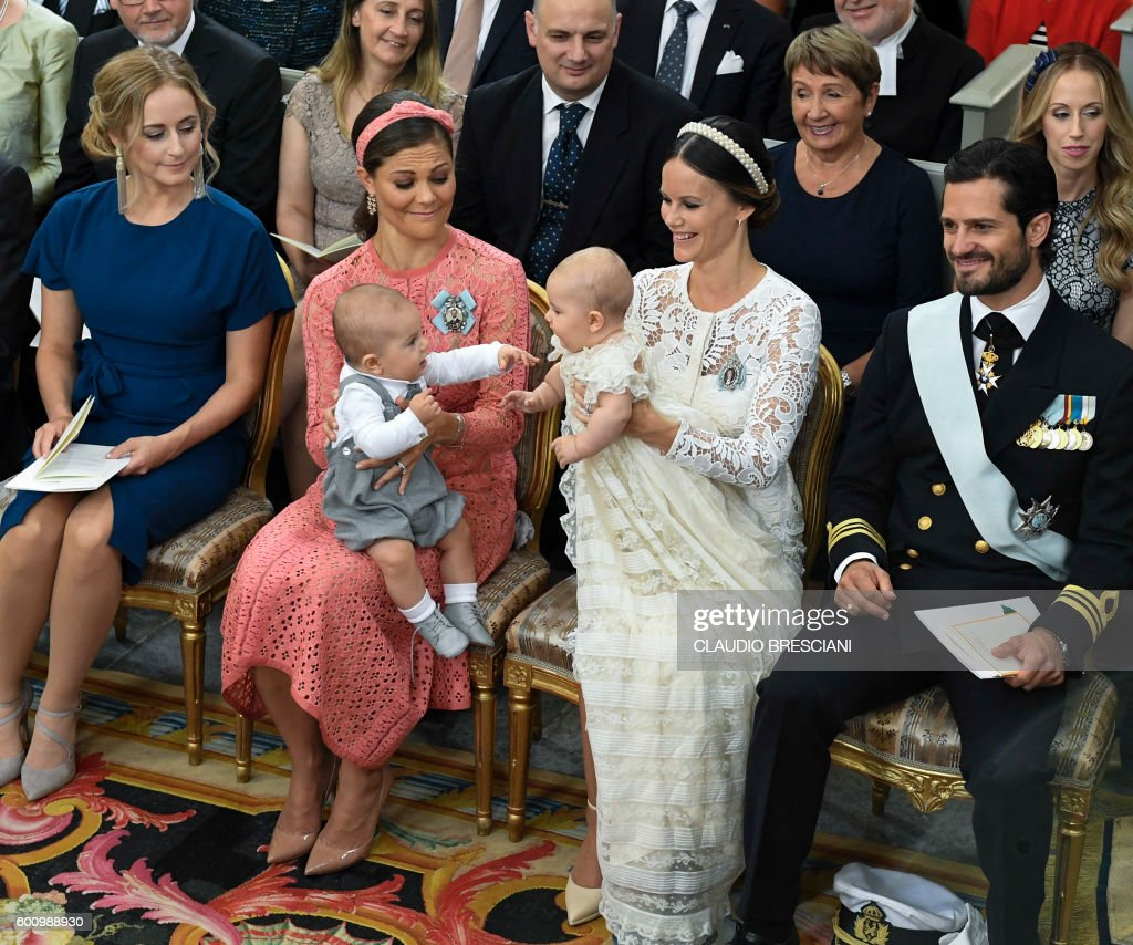 Crown Princess Victoria (2ndL) and Princess Sofia (2ndR) hold their sons Princes Oscar and Alexander at Palace Chapel in Drottningholm Palace in Stockholm during the christening of the five month-old Prince Alexander on September 9, 2016. News Agency / Claudio BRESCIANI / Sweden OUT