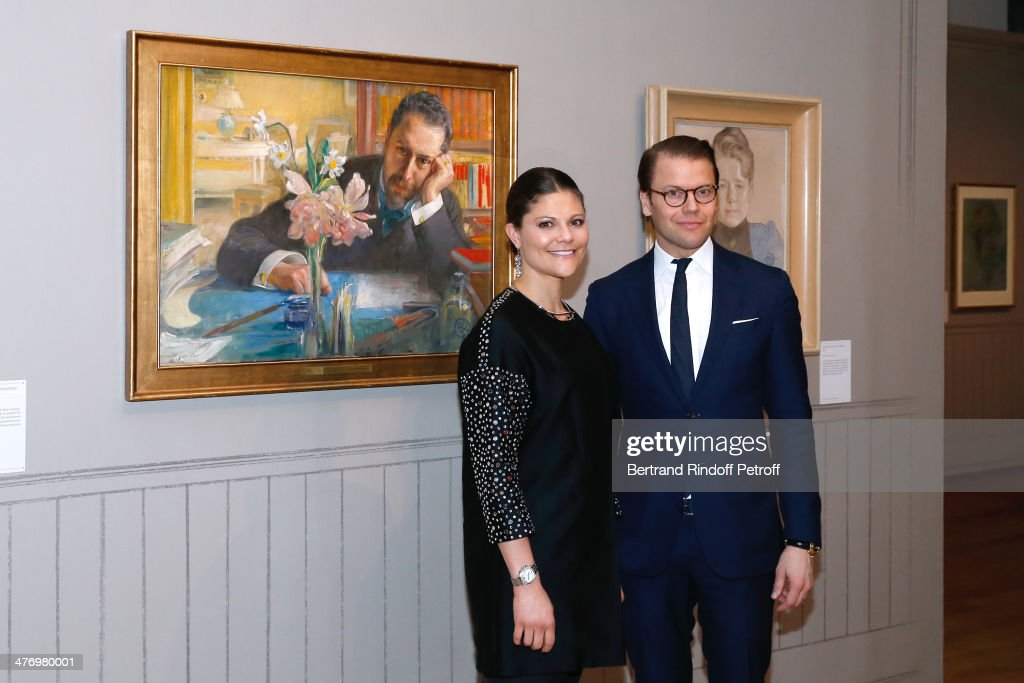 Crown Princess Victoria of Suede and her husband Duke of Vastergotland Daniel Westling posing near portrait of the poet Oscar Levertin as they open the Contemporary Artist Carl Larsson exhibition at 'Petit Palais' on March 6, 2014 in Paris, France.